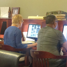 Patrons using computer workstations in the library